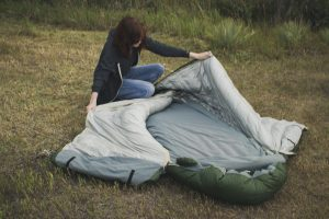 Girl with Warmlite triple down sleeping bag